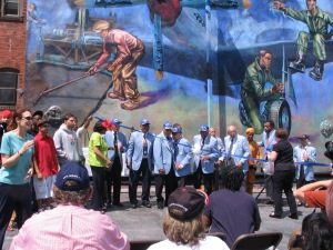 Jane Golden, Janie Blackwell Tuskegee Airmen, and the artists gather for Ribbon cutting